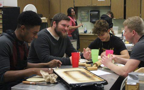 Senior group of friends Christian Malcom, Charlie Hinz, Bryce Nicholson and Austin Altum sit at their table and converse while eating their burritos.