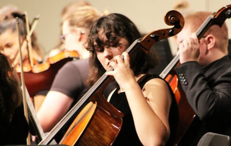 Sophomore Clara Rowe plays the cello at the orchestra concert on Nov. 2. This is Rowe's first year being apart of the concert orchestra.