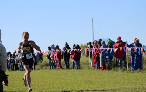 Junior Jonah Hodge runs the last stretch of the race. This will be Hodge's third trip to state.