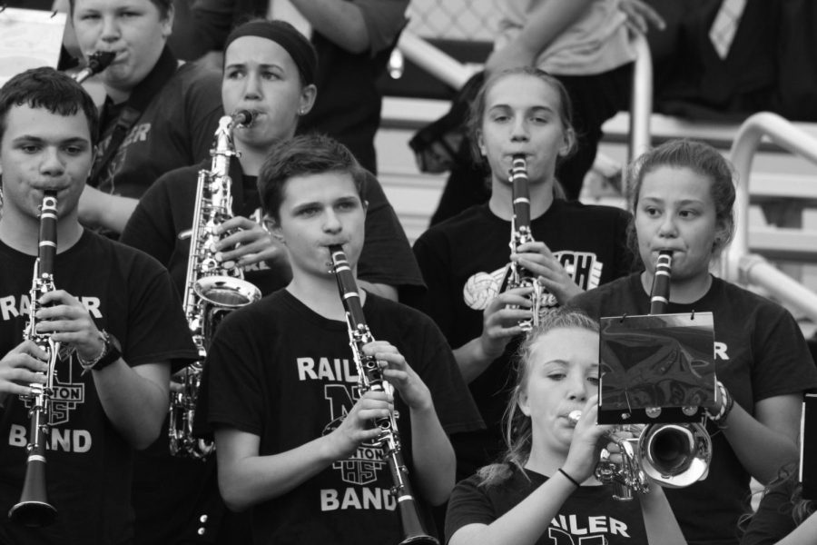 Clarinet players perform in the pep band during a varsity home football game on Sept. 1.
