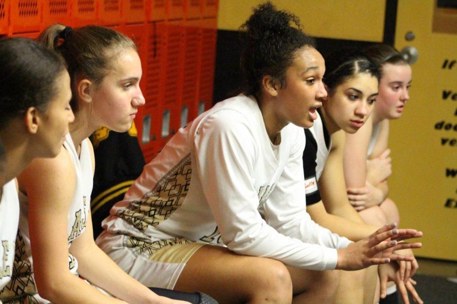 Back in the locker room, junior DesiRay Kernal talks to her teammates during halftime. Kernal is one of the teams captains alongside senior Jada Berry.