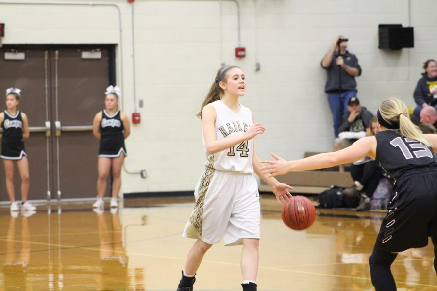 Senior Kyndal Bacon dribbles the ball up the court. Bacon also plays softball and volleyball.