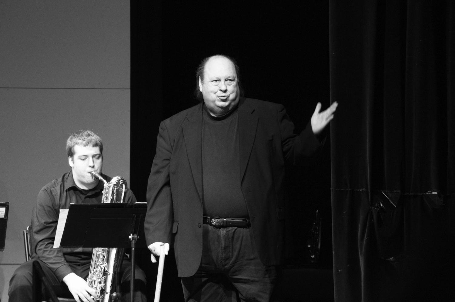Woolery speaks at the beginning of  a Jazz concert in March 2017.