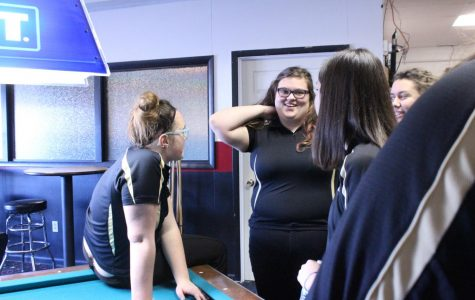 Members of the bowling team hangout before the begging of the meet. The team practices at Play-Mor.