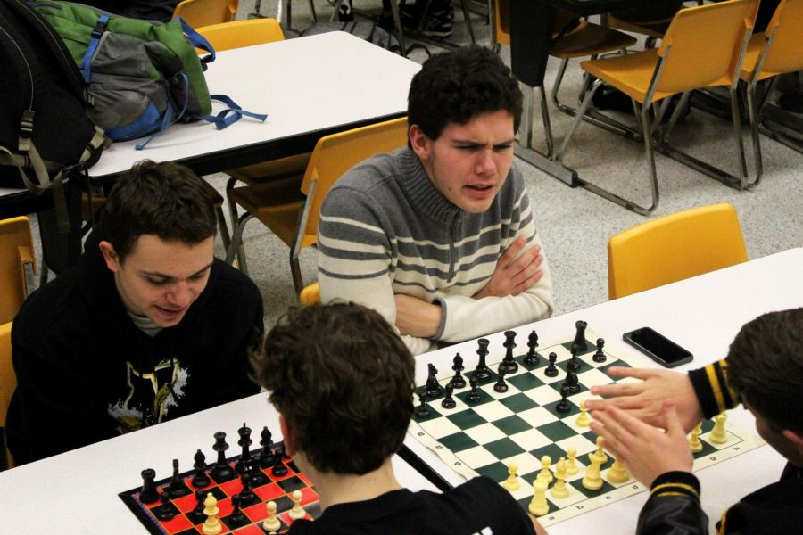 Arguing+with+his+competitor+sophomore+Eli+Blaufuss+enjoys+a+game+of+chess+next+to+sophomore+Joshua+Kennell+who+is+playing+his+own+game.+
