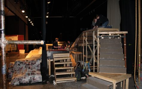 Student from the Technical Theater class work on the set for Brigadoon on Feb. 7. The show would open Feb. 15 and run through the weekend.