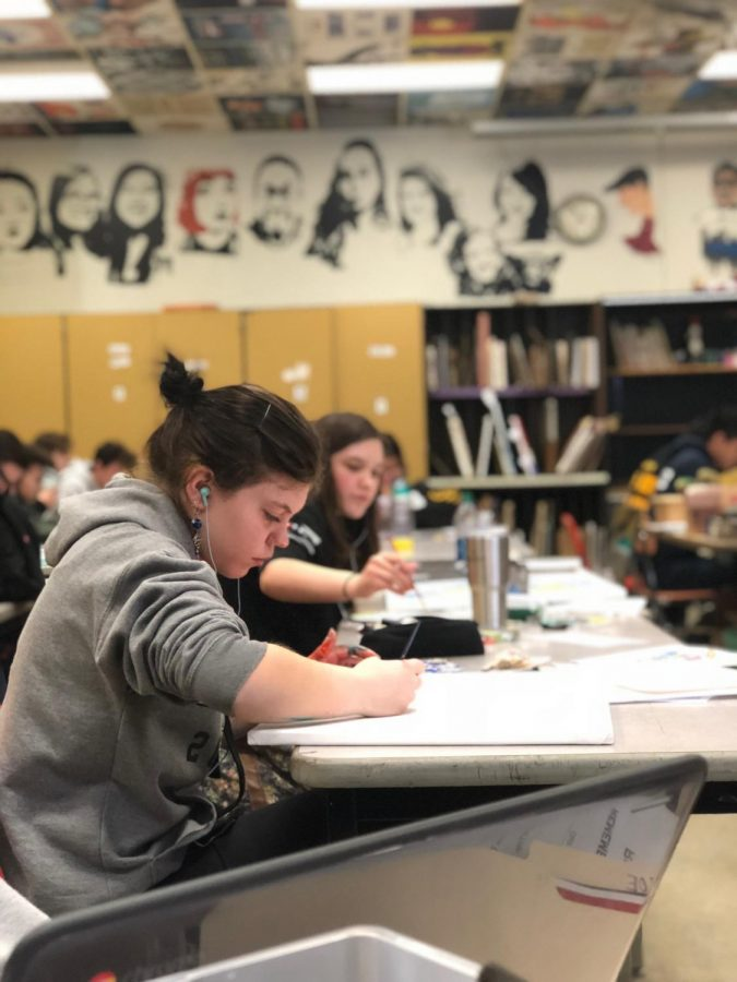 Senior Valentina Samuelli works on her reinterpretation  during Painting & Drawing II.