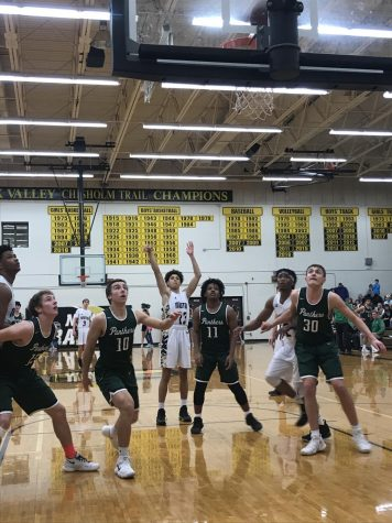 Railers basketball split varsity matchups against Derby