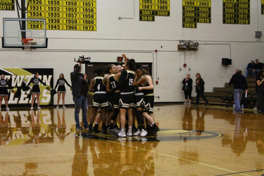 As+they+celebrate+their+victory%2C+the+Lady+Railers+huddle+with+tears+on+their+faces+on+Jan.+26.+A+cameraman+from+KWCH+recorded+their+victory.