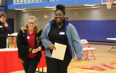 Walking of center stage seniors Kylee Breon and Linda Moyo celebrate their win of silver at competition. Over the past few months, Breon and Moyo worked on planning a farewell party for the foreign exchange students.