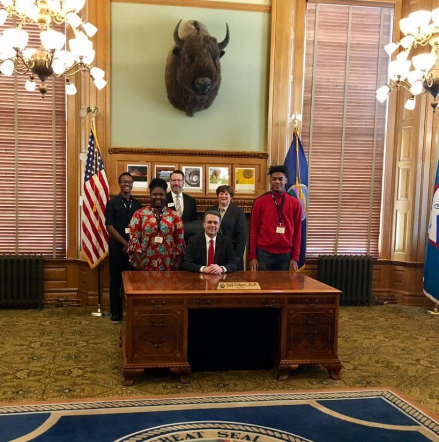 Senior Linda Moyo stands with other JAG-K leaders and Governor Jeff Colyer on Feb. 21 at the capitol building in Topeka, Kan. As the state president of JAG, Moyo was recognized by the Senate and House gallery and gave a speech during her visit.