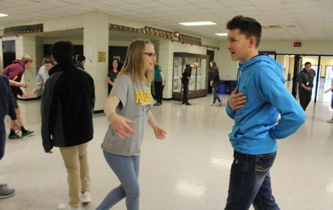 Liberty Tegethoff and Max Musser start their dance with a bow.