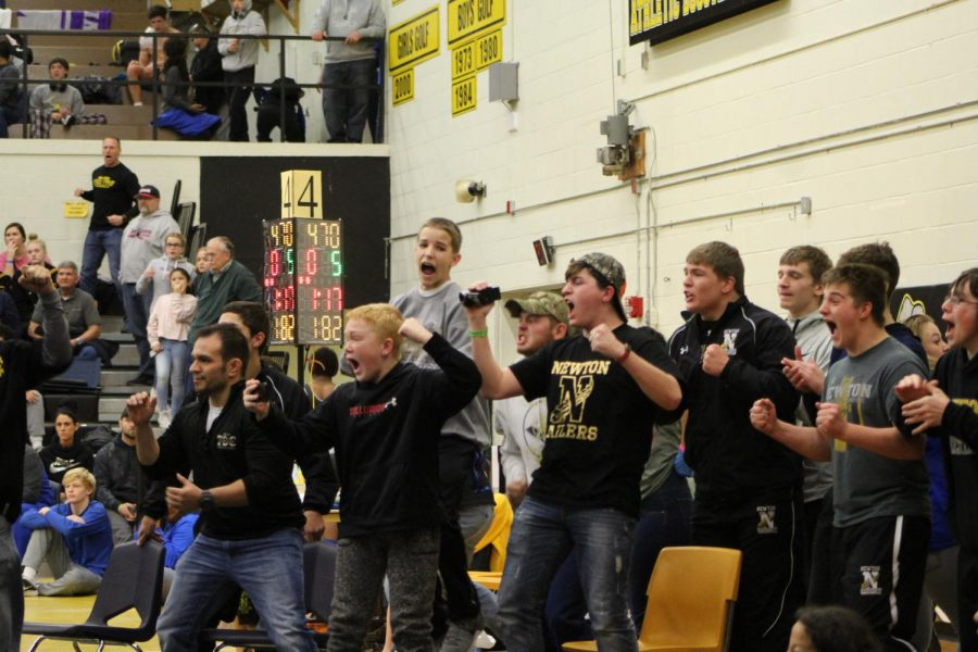 Newton fans celebrate after Dante Harper gets a big win during his last match in TOC.   The wrestling team traveled to Valley Center to compete in regionals on Feb. 16. To prepare for the important upcoming tournaments, they had two practices each day for a week. The regular season ended with a team record of 3-3.