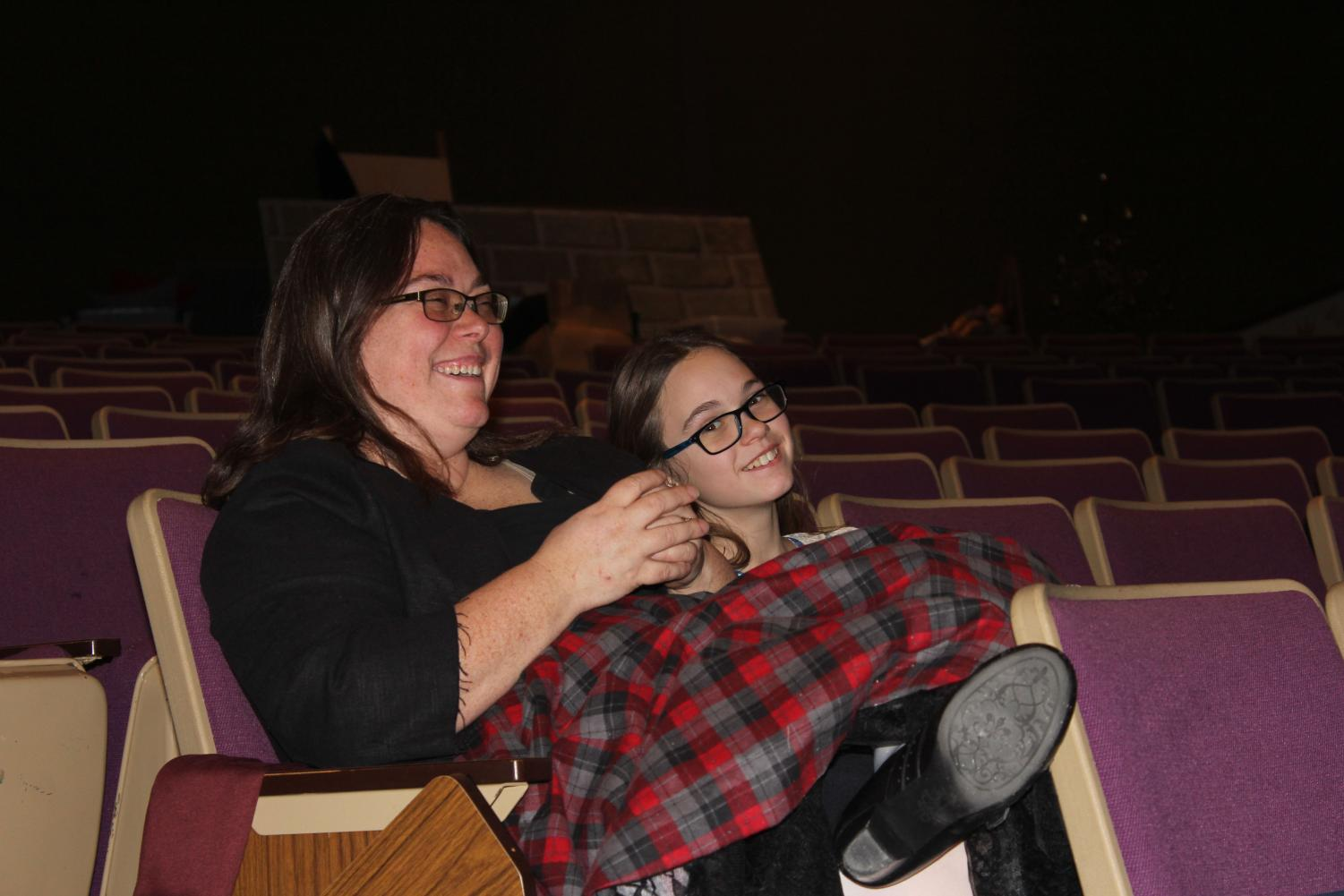 Math teacher Jennifer Horn sits with her daughter at rehearsals for Brigadoon. This year, district staff members were invited to participate in the production.