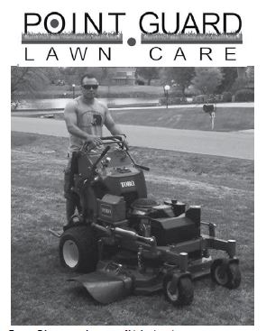 Tommy Edgmon stands on one of his business' mowers.
