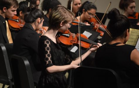 Freshman Acacia Penner plays during the concert. Freshmen orchestra went first that night.