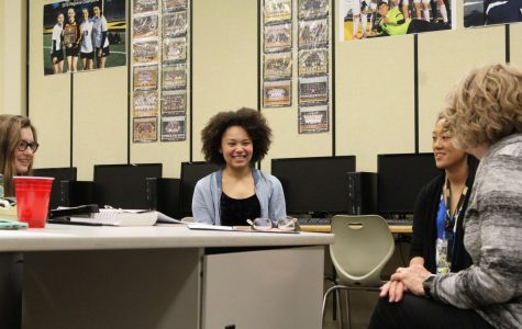 Senior Gracie Hammond laughs as her and fellow journalism representatives discuss what's going on in their classes.