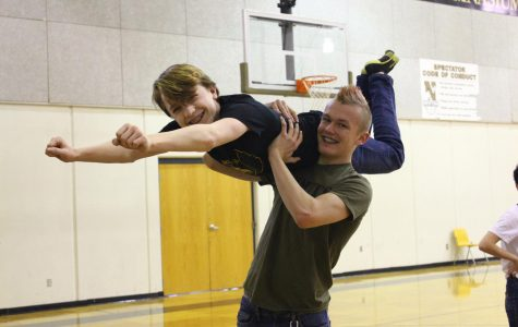 Posing for the camera, freshman Creed Ekerberg lifts freshman Jacob Phillips into the air. Ekerberg and Phillips learned multiple new dance moves in swing dance club.
