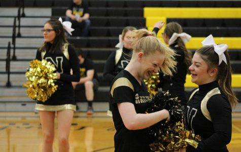 Sisterly love, senior Allyssa Meyer shares a laugh with her sister, sophomore Becca Meyer.