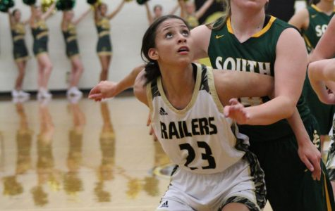 Jada Berry looks to get the rebound after a teammate shoots a free throw.