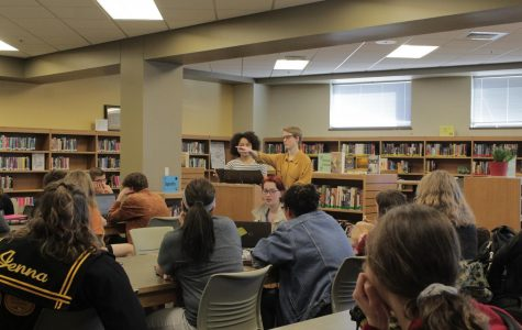 Senior Gracie Hammond and Junior Quinn Rhodes lead a meeting  on Thursday, March 1 to organize the gun violence protest that will take place at our school Wednesday, March 14.