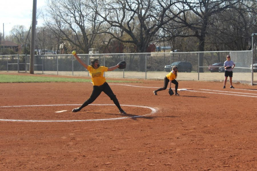 Newton Softball players work to win while on defense.