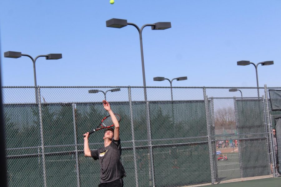Junior Seth Bontrager serves a ball to the other team on April 5. Bontragers has played Tennis for six years.