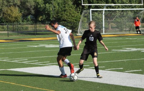 Freshman Benjamin Friesen Guhr defends against an outside wing player during their second home game against the Eisenhower Tigers on Sept. 20.