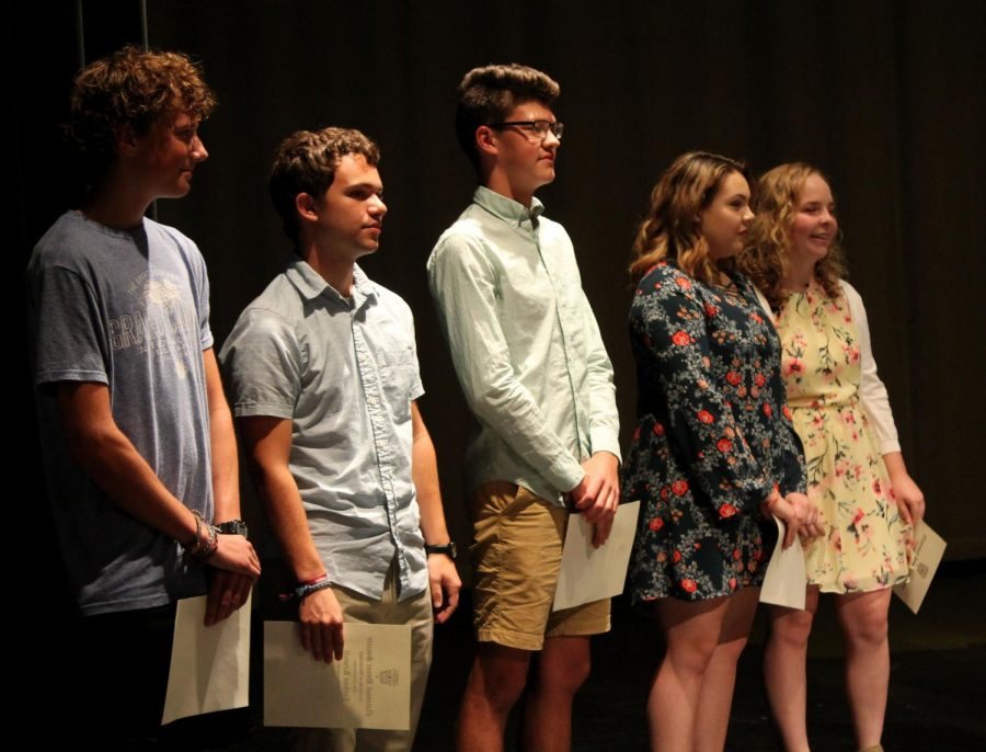 Juniors+John+Jantzen%2C+Joshua+Kennell%2C+senior+Seth+Bontrager%2C+and+juniors+Hanna+Brown+and+Kayla+Anderson+recite+the+induction+pledge.