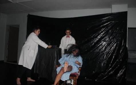 Kayla Wong plays a patient that is electrocuted by Sophomore Abi Boese and David Kliewer who performed as electric chair technicians.