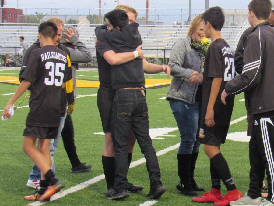 Senior+Chase+Ebert+hugs+sophomore+Omar+Hernandez+after+being+announced.+