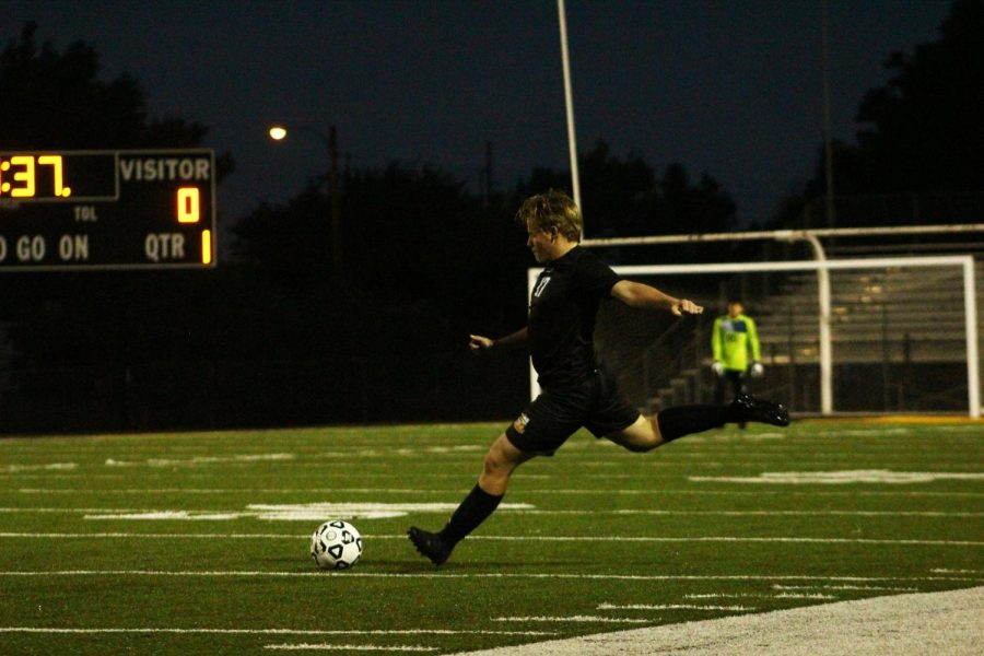 Senior Chase Ebert kicks the ball.