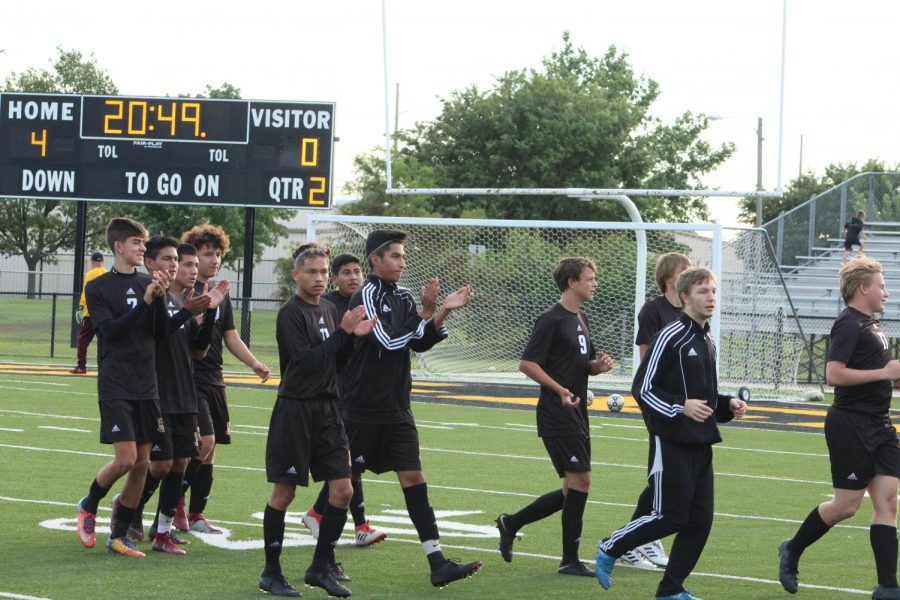 The+Varsity+soccer+team+runs+over+to+the+crowd+during+pre+game.+They+were+celebrating+the+JV%E2%80%99s+4-0+victory+over+Hutchison.+