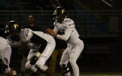Varsity football plays under Thursday night lights, possibility of hosting playoff game
