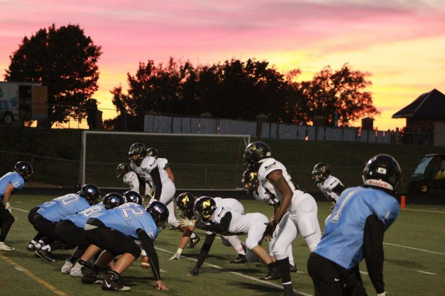 As+the+sun+sets+the+defense+gets+into+position+before+an+Eisenhower+play.++