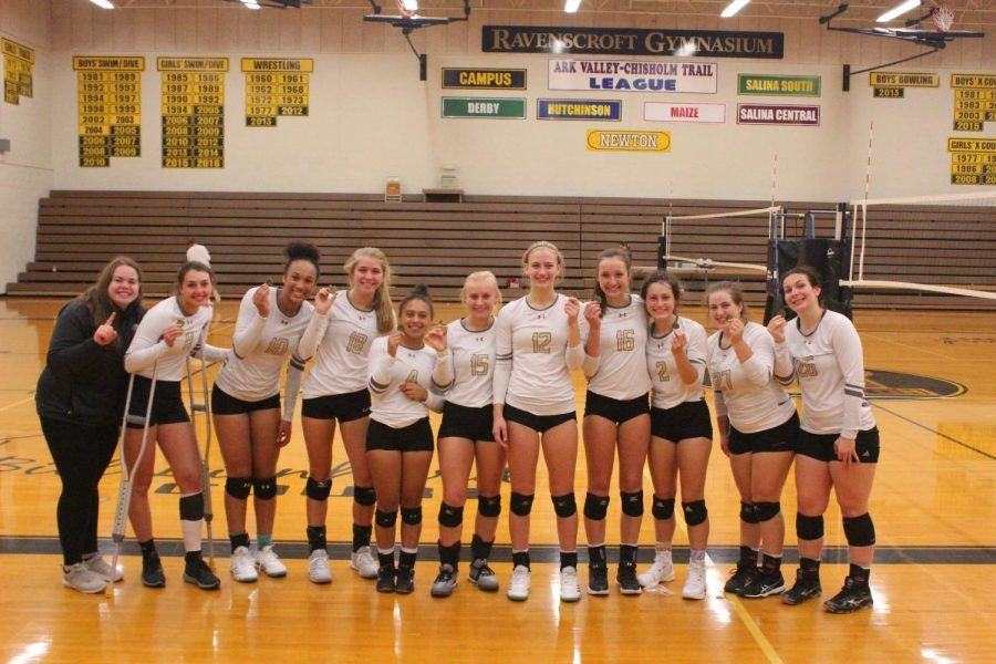 Varsity+takes+first+at+home+volleyball+tournament.