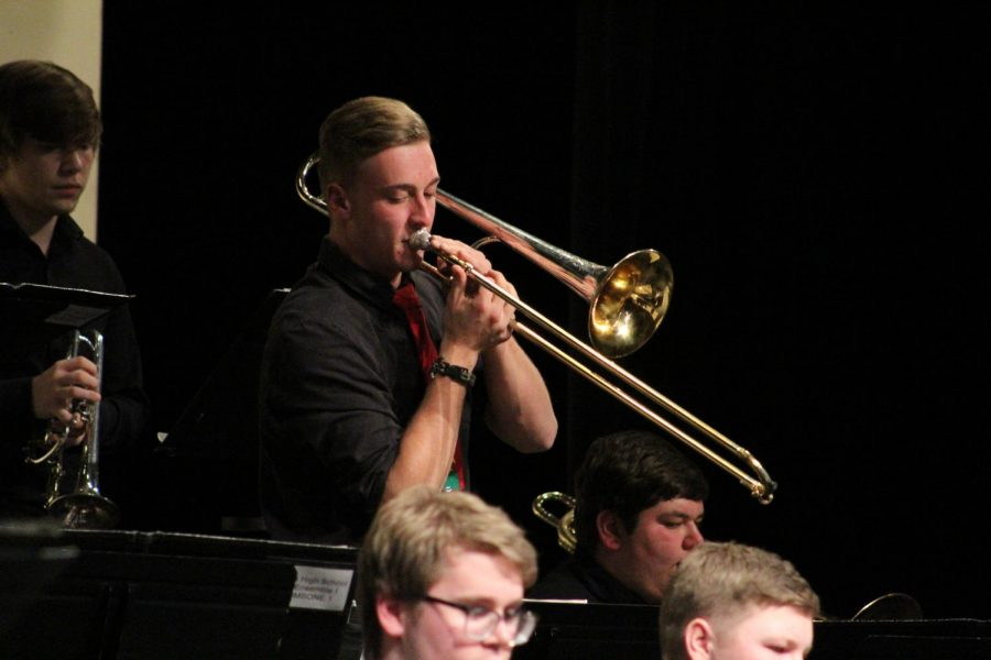 Standing+for+his+solo+junior+Zach+Stenzel+plays+his+trombone.+