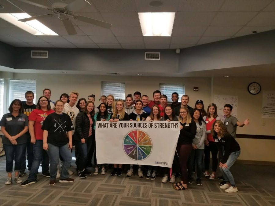 Students in Sources of Strength pose for a group photo with the staff leaders and the trainer on Oct. 26 at the Educational Technology Center (ETC).  The training helped students understand how to connect with others to provide a sense of belonging.