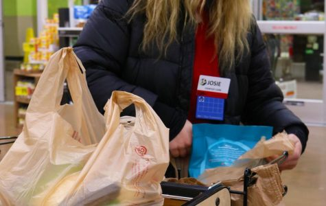 Sophomore Josie Bacon bags groceries for a customer on Wednesday Jan. 16. Bacon works at north Dillons.