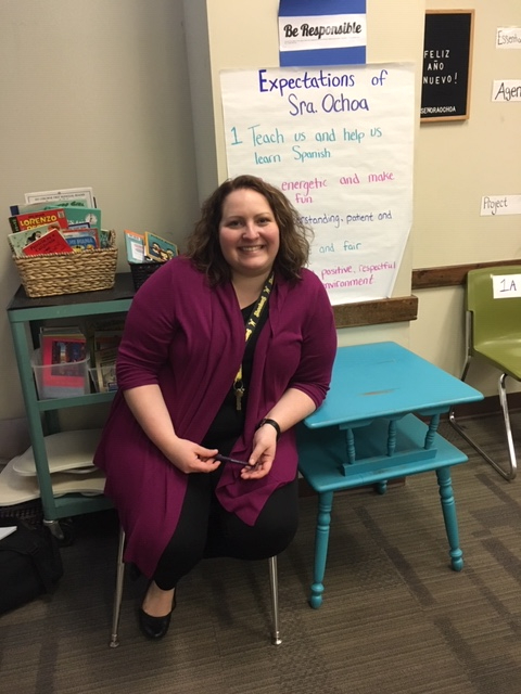 Spanish teacher Chandlor Ochoa sits in her room in front of her class expectations poster. Ochoa   was recognized as the region four Horizon Award winner for secondary education.