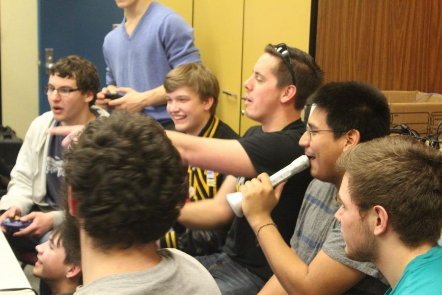 Students participating in a tournament during the first club meeting play Super Smash Bros. Ultimate on the Nintendo Switch.