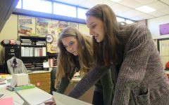 As the only two members of Ed Rising club, seniors Mollee Ewart-Smith and Naomi Kuhn work on making a poster.