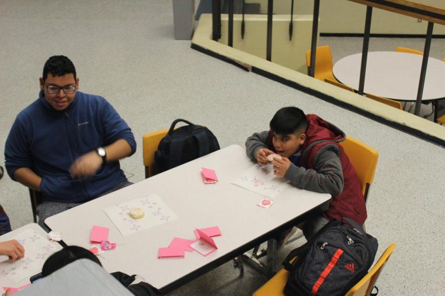 Freshman+Misael+Campos+Cisneros+prepares+to+eat+a+cookie.+