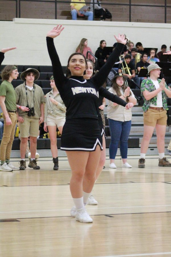 During introductions, sophomore Toria Thaw waves to the crowd.