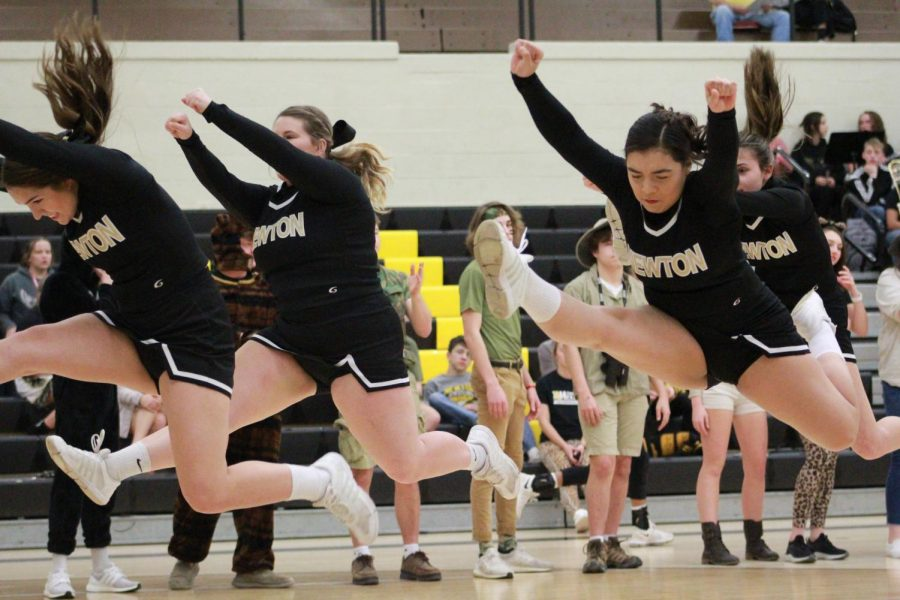 Sophomores Libby Crawford and Toria Thaw perform  right front during introductions of the girls basketball game.