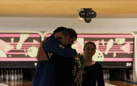 After receiving his yellow rose, senior Treyton Rice embraces his father during the senior night ceremony at Play-Mor Lanes.