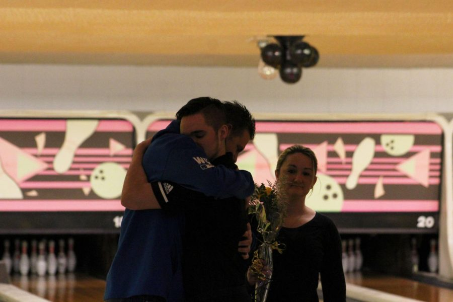 After+receiving+his+yellow+rose%2C+senior+Treyton+Rice+embraces+his+father+during+the+senior+night+ceremony+at+Play-Mor+Lanes.+
