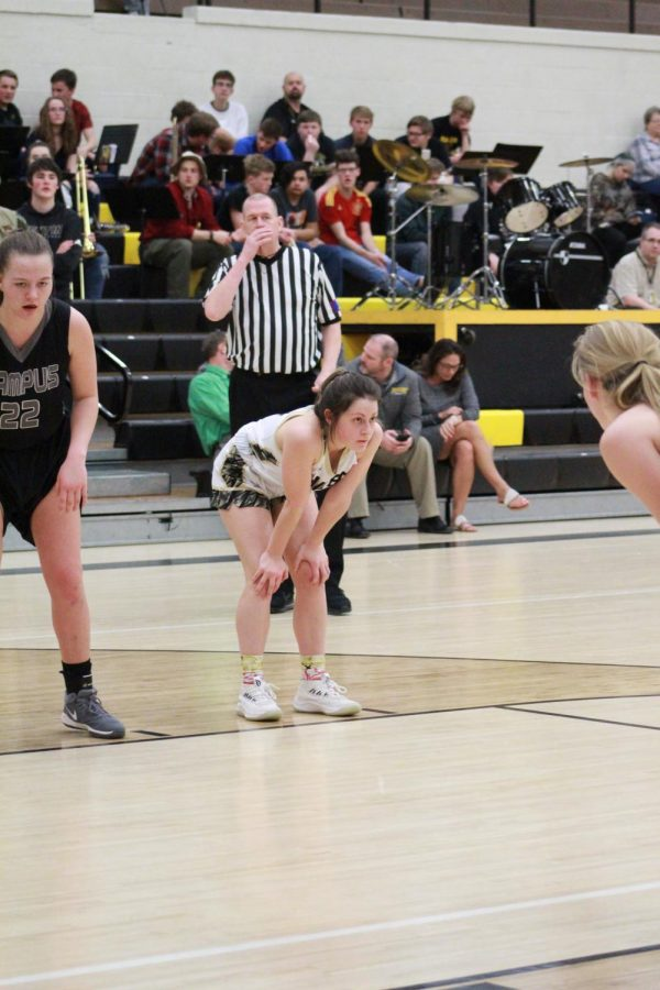 Taking a break, sophomore Marah Zenner waits for the opposing team to shoot their free throw.