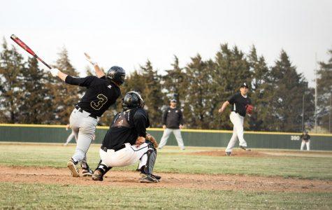 Junior Gavin Cusick hits a single during the March 22 Alumni Game.