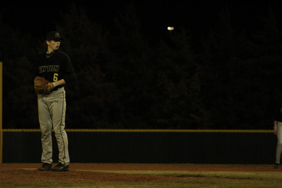 Senior Zach Kennell focuses before he begins his first pitch of the inning.